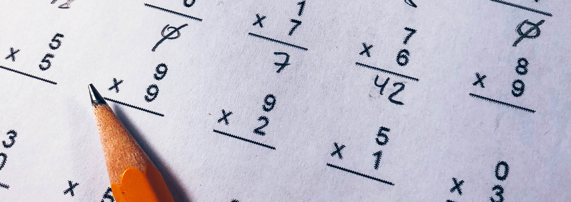 A piece of paper with single-digit multiplication problems and a pencil.